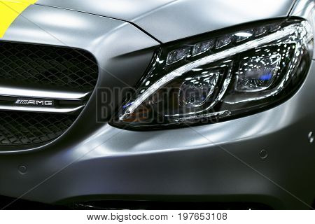 Sankt-Petersburg Russia July 21 2017: Front view of a Mercedes Benz C 63s AMG coupe 2017. Front Headlight. dark Matt colour .Car exterior details. Photo Taken at Royal Auto Show July 21