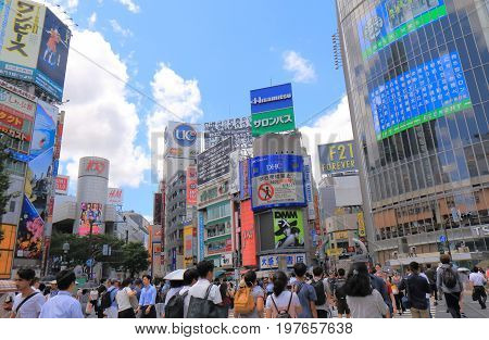 TOKYO JAPAN - JULY 11, 2017:  Busy Shibuya crossing. Shibuya is known as one of the fashion centers of Japan for young people, and as a major nightlife area.