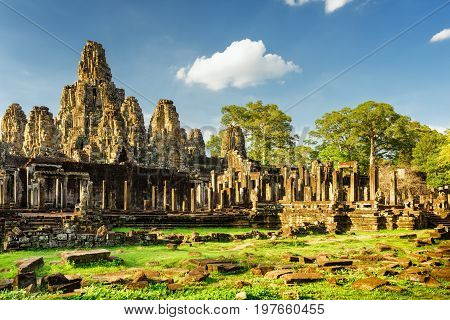 Giant Stone Faces Of Bayon Temple In Angkor Thom, Cambodia