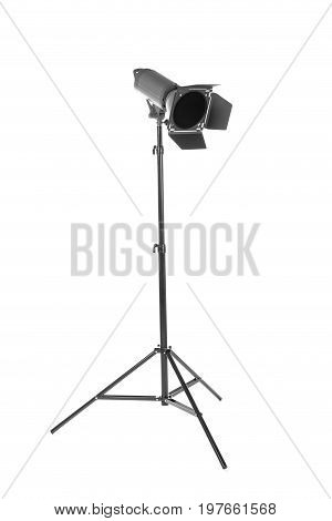 Studio flash with barn door, isolated on a white background. Photo-studio with lighting equipment. Studio lighting on a tripod stand. Spot light photography equipment.