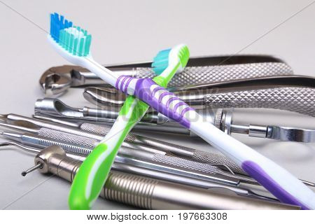 dental care toothbrush with dentist tools isolated on white background. Selective focus