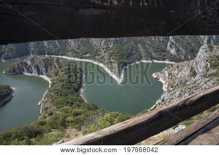 River Meanders Between Defocused Wood Bars