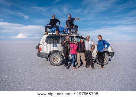 Uyuni, Bolivia- March 25, 2017: People taking picture on the lake Salar de Uyuni Bolivia