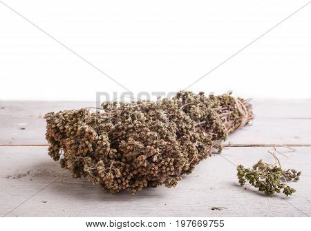 Close up of dried oregano herb on white table