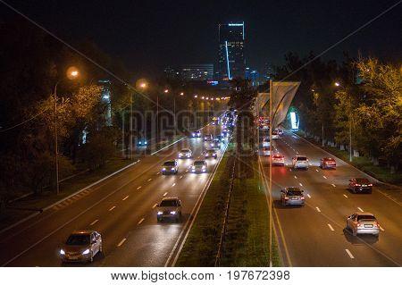 ALMATY KAZAKHSTAN - MAY 6: Almaty city night view Al-Farabi avenue. Light trails at night on the road on May 6 2017 in Almaty Kazakhstan.