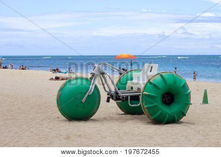 Honolulu Hawaii USA - May 25 2016: Aqua-Cycle Water Trike for rent on Waikiki Beach.