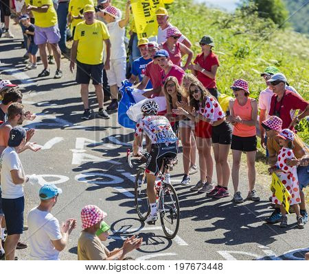 Col du Grand ColombierFrance - July 17 2016: The Belgian cyclist Thomas De Gendt in Polka Dot Jersey riding on the road to Col du Grand Colombier in Jura Mountains during the stage 15 of Tour de France 2016.
