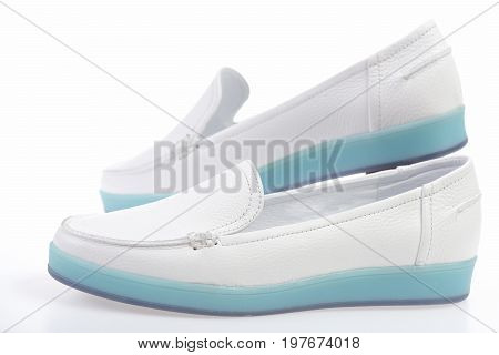 Pair Of Female Leather Sports Shoes Isolated On White Background