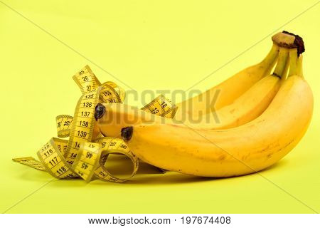 Fruit And Measuring Tape Composition, Isolated On Light Yellow Background