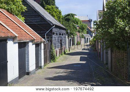 Old cozy street in Buren in the Netherlands