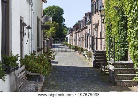 Cozy old street with cobblestones in Buren in the Netherlands