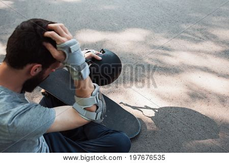 Extreme sport painful injury. Head trauma accident on skateboard park.