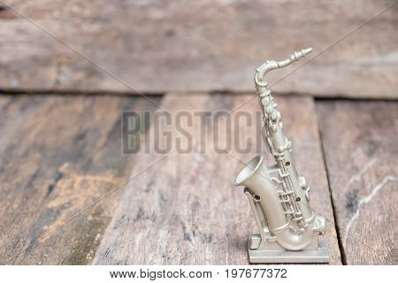 saxophone for decorate old on vintage wooden background with copy space add text