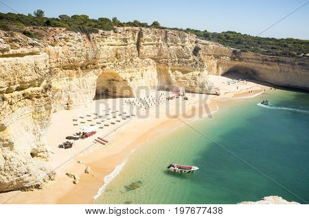 Beach ready to relax tourists at Praia da Marinha in Portugal Algarve, Private beach for tourists, Beautiful beach with boat