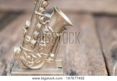 saxophone for decorate old close up on vintage wooden background with copy space add text
