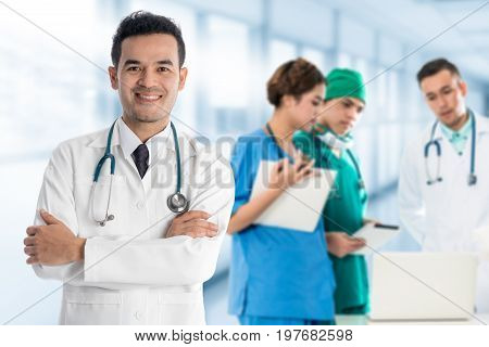 Medical people - Doctors nurse and surgeon in group meeting. Selective focus at front doctor.