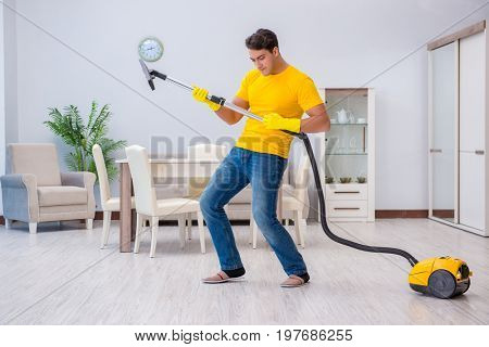 Young man doing chores at home