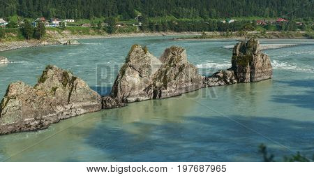 Fast mountain river Katun in Altay, Siberia, Russia. A popular tourist place called the Dragon's Teeth