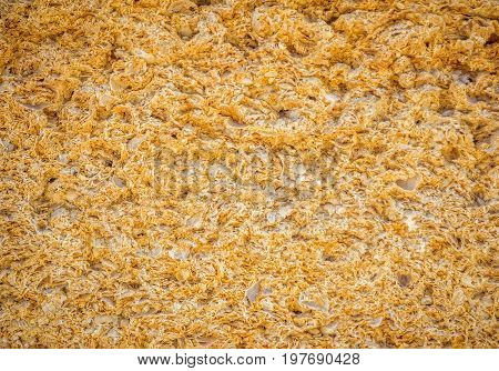 Yellow porous texture of  natural shell stone wall. Coquina or lemonstone material background.