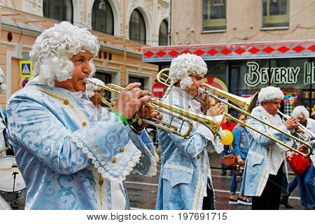 Moscow Russia - September 05 2015: Musicians dressed in 18th-century clothes with a trumpet on City Day on Tverskaya Street in Moscow