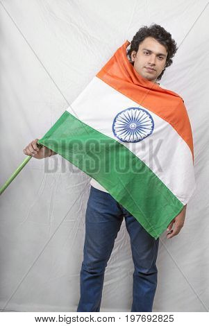indian male model posing indian flag with blue jeans