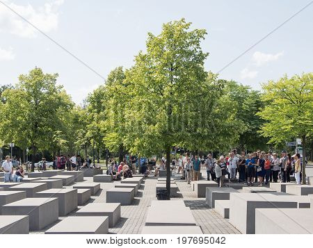 BERLIN GERMANY - JULY 30 2017: Tourists At The Memorial to the Murdered Jews of Europe