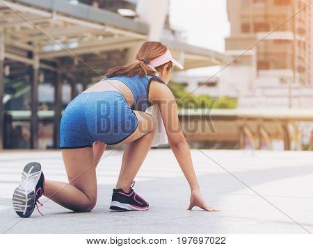 Woman Runner In Starting Running Position