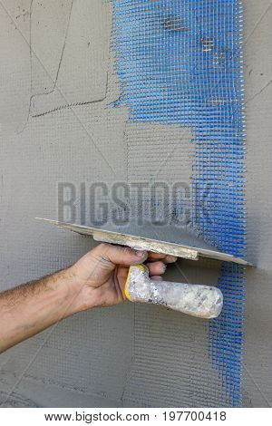Facade Plaster Hand Smoothing Out Wall With Trowel
