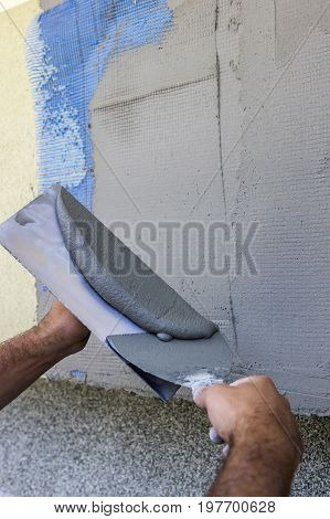Facade Plaster Hand Smoothing Out Wall With Trowel 2