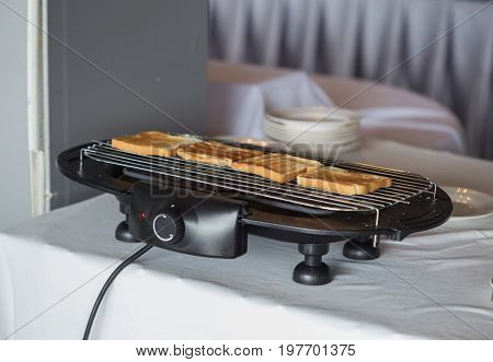 Toast bread on a toaster in hotel