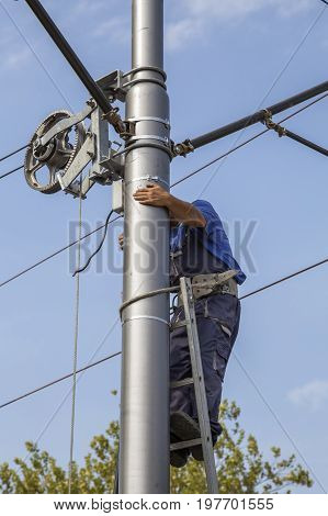 Linemen Installing Tram Supply Power System