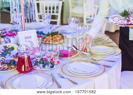 Serving a wedding dinner. Catering service concept