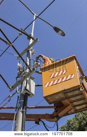 Lineworker Works On Power Overhead