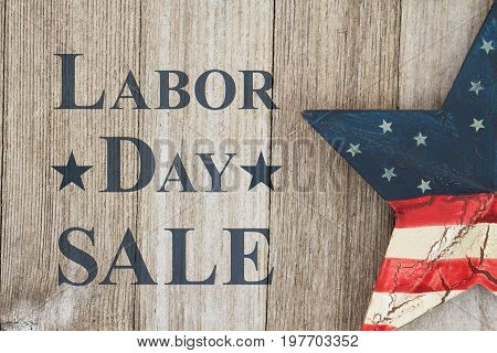 Labor Day sale message USA patriotic old star on a weathered wood background with text Labor Day Sale