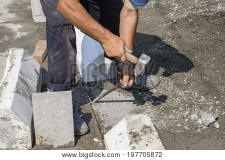 Worker Using Chisel And Hammer For Paving Work 2
