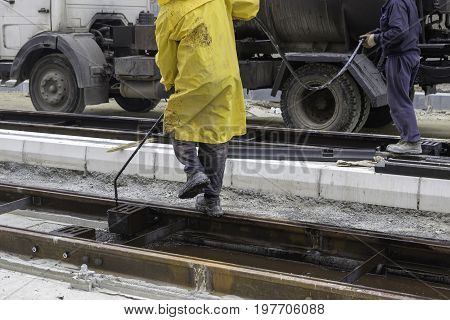 Workers Sprays Bitumen Emulsion Onto The Road 2