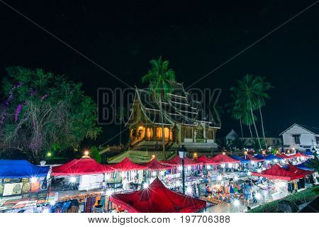 LUANG PRABANG LAOS - MARCH 11 2017: From the top horizontal picture of Haw Pha Bang and Night Market located on the grounds of the Royal Palace Museum in Luang Prabang Laos.