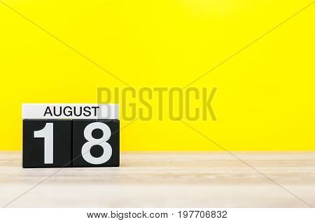 August 18th. Image of august 18, calendar on yellow background with empty space for text. Summer time.