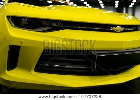 Sankt-Petersburg Russia July 21 2017: Front view of a yellow Chevrolet Camaro 2017. Car exterior details. Photo Taken on Royal Auto Show July 21