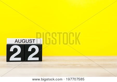 August 22nd. Image of august 22, calendar on yellow background with empty space for text. Summer time.