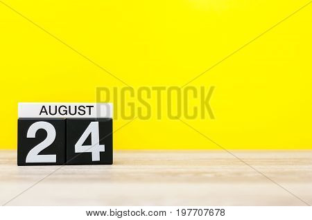 August 24th. Image of august 24, calendar on yellow background with empty space for text. Summer time.