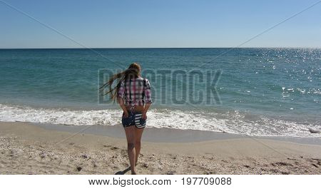 Young girl enjoy sunset on coast silhouette romantic person relax on the beach seascape.