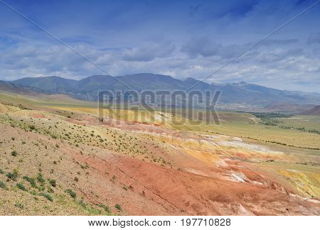 View of red and yellow hills. Landscape of steppe and colorful Altai mountains. Altay Republic Russia.