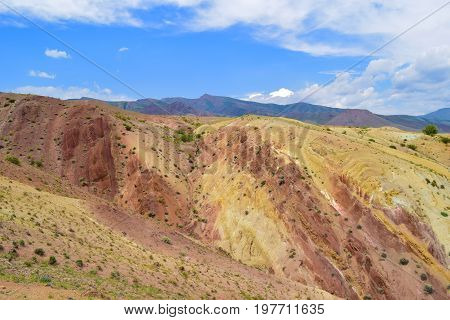 Martian landscape of Altai mountains. Colorful hill slopes. Altay Republic Russia.