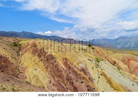 Deserted martian landscape of Altai mountains. Colorful hill slopes. Altay Republic Russia.