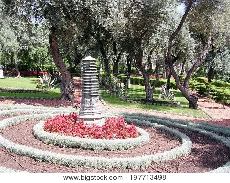 Flowerbed with sculpture in Bahai Gardens in Haifa Israel