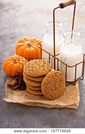 Fall pumpkin cookies with milk in bottles