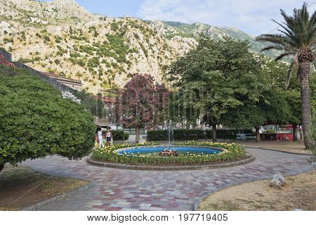 KOTOR MONTENEGRO - JUNE 30 2017: Beautiful park near the old town of Kotor always attract tourists