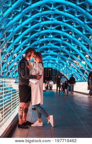 Loving couple on the bridge of Peace in Tbilisi, Georgia