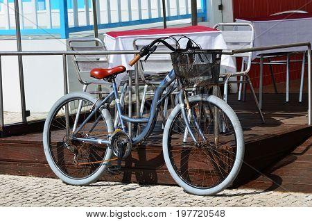 Parked bicycles on sidewalk. Bike parking on the street in Costa Nova Aveiro Portugal